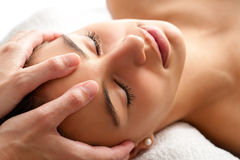 Macro relaxing facial massage. Royalty Free Stock Images