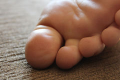Macro of a Resting Foot on a Couch in the Morning Sunlight Royalty Free Stock Photos