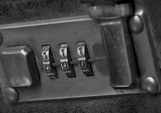 Retro briefcase lock. Macro of a retro briefcase locking mechanism set to the ominous zero one sequenceing input numerical pattern. black and white closeup stock images