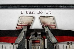 Macro of the ribbon and paper of typewriter with positive confident message Stock Images