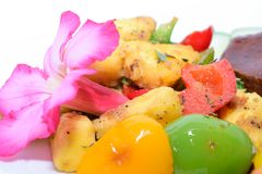 Macro Roasted Breadfruit with Red, Yellow and Green Peppers Royalty Free Stock Photo