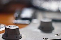 Macro roche d'instrument de musique de guitare Photographie stock