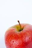 Macro roja aislada de la manzana Imagen de archivo libre de regalías