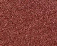 Macro roja de la textura del papel de lija Fotos de archivo