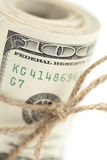 Macro Roll of One Hundred Dollar Bills Tied in Burlap String on White. Roll of One Hundred Dollar Bills Tied in Burlap String Isolated on a White Background Stock Photos