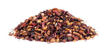 Macro of rose hip tea loose leaf granules in a pile on white background Royalty Free Stock Image