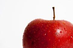 Macro rossa isolata della mela Immagini Stock