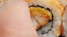 Macro salmon maki roll. sushi cuisine with fresh raw fish stock video footage