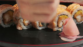 Macro salmon maki roll. sushi cuisine with fresh raw fish stock footage
