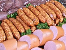 Fresh sausages on a party plate royalty free stock images