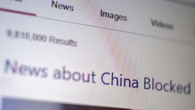Macro screen shot of computer with text News about China blocked. Blurred. Selective focus. Shallow depth of field. Pixelate super. Macro screen shot of computer stock photo