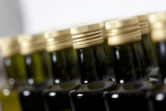 Macro of screw caps on glass bottles. Stock Photo