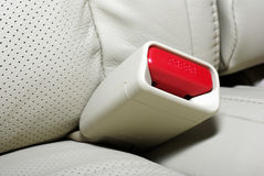 Macro of seat belt button. Royalty Free Stock Image