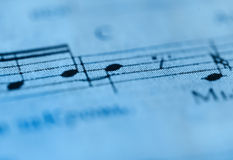 Macro of sheet music in blue tones Stock Photo