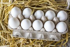 Macro shoot of brown / white  eggs at hay nest in chicken farm.  stock images