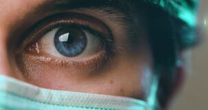 Blue Eye of a doctor with mask