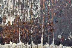 Macro shoot of small  part of   grunge bench seat 11. Close-up of  old, decaying,peeled ,scratched, rough,brown and grey wooden board surface Stock Photography