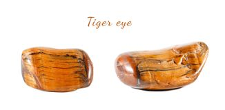 Macro shooting of natural gemstone. Mineral tiger eye, South Africa. Isolated object on a white background. Macro shooting of natural gemstone.Mineral tiger eye Stock Photo