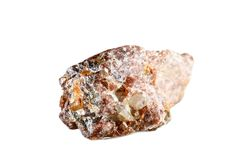 Macro shooting of natural gemstone. The raw mineral is andalusite. China. Isolated object on a white background. Macro shooting of natural gemstone. The raw stock image