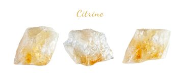 Macro shooting of natural gemstone. The raw mineral is citrine. Brazil. Isolated object on a white background. Macro shooting of natural gemstone. The raw Stock Photo