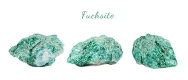 Macro shooting of natural gemstone. Raw mineral fuchsite. Isolated object on a white background. Macro shooting of natural gemstone. Raw mineral fuchsite Stock Images