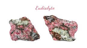 Macro shooting of natural gemstone. Natural rock specimen of eudialyte. Isolated object on a white background. Macro shooting of natural gemstone. Natural rock Stock Images