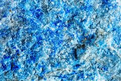 Macro shooting of natural gemstone. The texture of the mineral lazurite. Abstract background. Macro shooting of natural gemstone. The texture of the mineral royalty free stock photos