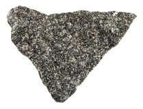Raw olivinite stone isolated on white. Macro shooting of natural mineral rock specimen - raw olivinite stone isolated on white background from Kovdor region Royalty Free Stock Photo