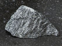 rough dolerite stone on dark background Stock Photo