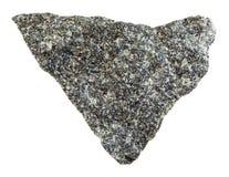 Rough olivinite stone isolated on white. Macro shooting of natural mineral rock specimen - rough olivinite stone isolated on white background from Kovdor region Stock Photography