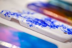 Macro shot of abstract painted mobile phone cases. Stock Photo