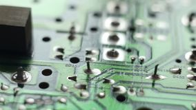 Macro shot of the back side of a circuit board stock footage