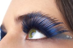 Macro shot of beautiful eyes. Macro shot of beautiful green eyes with bright blue make-up and fake eyelashes. Not a crop. Shallow depth of field Stock Photography