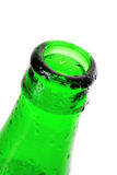 Macro shot of beer bottle with water drops Stock Images