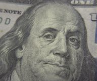 Closeup of Benjamin Franklin on the one hundred dollar bill. Macro shot of Benjamin Franklin on the US one hundred dollar bill Royalty Free Stock Image