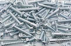 A Macro Shot of A Big Collection Of Iron Screws, Nuts and Lockwashers Royalty Free Stock Images