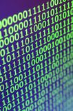 Macro shot of binary code on the monitor of an office computer. The concept of the programmer`s work. The flow of digital informa royalty free stock photos