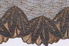The macro shot of the black and brown lace texture material. L Royalty Free Stock Photo