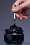 Macro shot of black caviare. Macro shot of caviare in glass. Premium european product Stock Image