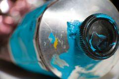 Macro shot of blue paint tube. Macro shot of blue metal paint tube Royalty Free Stock Photos