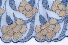 Macro shot of the blue and yellow lace texture material Royalty Free Stock Image