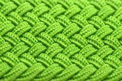 Green Interwoven Fabric Texture. A macro shot of bright green interwoven fabric texture – horizontal orientation Royalty Free Stock Images