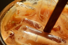 Macro shot of brown straw in ice coffee Royalty Free Stock Photography