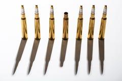 Macro shot of bullet casings on a white studio Stock Images