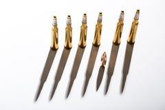 Macro shot of bullet casings on a white studio Stock Photo