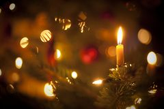 Candle on christmas tree Stock Images