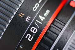 Macro shot of a camera lens focusing on camera lens. Information the aperture size f 2.8 and ens focal length is 14 mm Royalty Free Stock Image