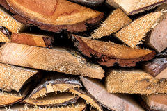 Macro shot of chopped pine wood stacked in pile Stock Images