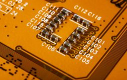 Macro shot of Circuit board with resistors microchips and electronic components. Computer hardware technology. Integrated communic stock images