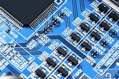 Macro shot of a Circuitboard with resistors microchips and electronic components. Computer hardware technology. Integrated communi stock photos